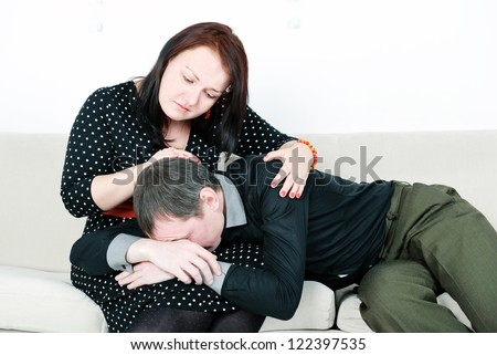 Woman comforting her crying man - stock photo