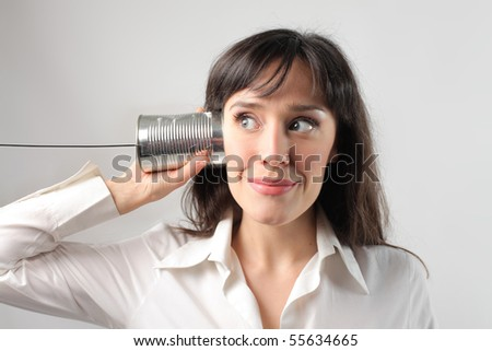 Woman communicating with a metal jar and a cable - stock photo