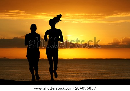 Woman competing in a distance running race - stock photo