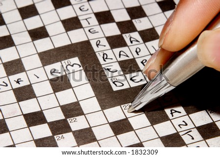 Woman completing crossword - stock photo