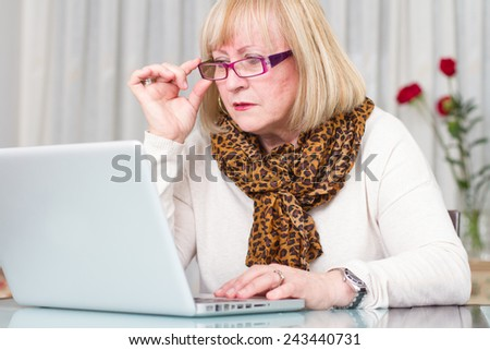 Woman concentrated working with her computer - stock photo