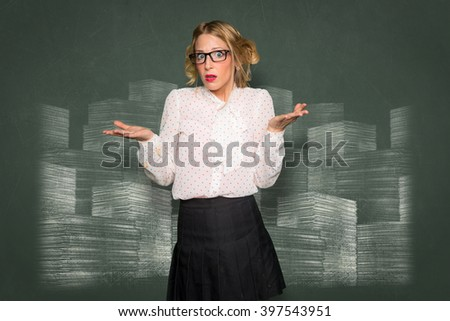 Woman confused clueless helpless unsure puzzled baffled paperwork overwhelmed stack of papers - stock photo