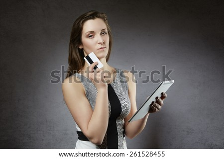 Woman considering shopping online - stock photo