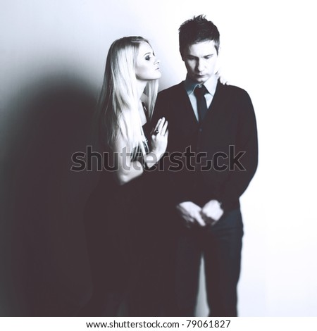 Woman consoles her sad friend. Photo of young couple