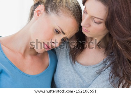 Woman consoling her friend and looking at her - stock photo