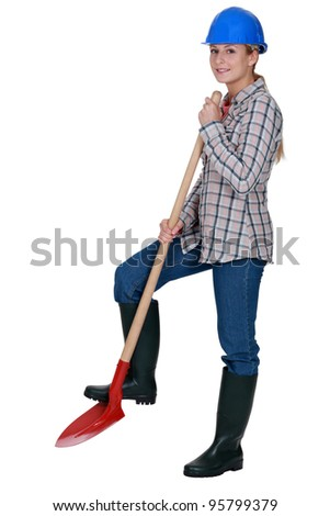 Woman construction worker with a shovel