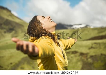 Woman contemplating a beautiful landscape - stock photo