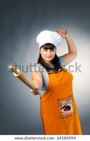 woman cook fencing with rolling pin - stock photo
