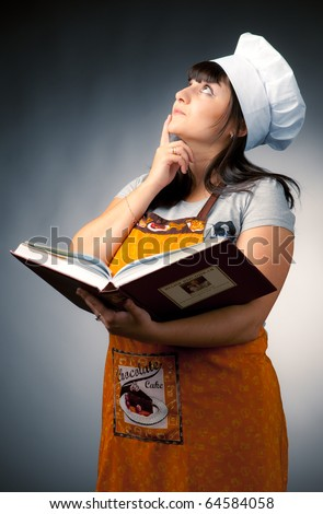 woman cook holding recipes book and thinking what to cook - stock photo