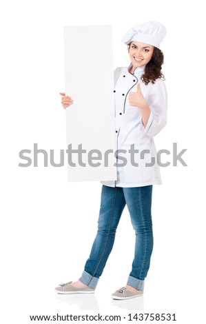 Woman cook in chef hat showing blank placard board, isolated on white background. - stock photo