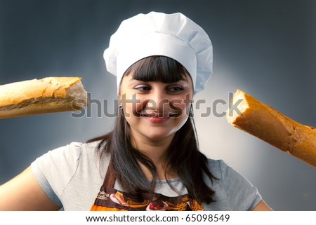 woman cook with breaked french bread - stock photo