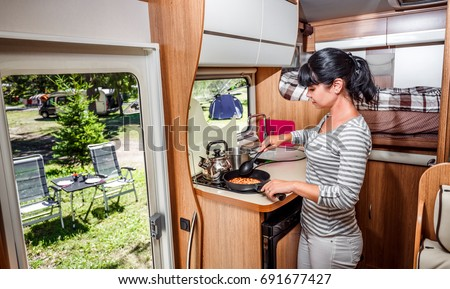 Woman Cooking In Camper, Motorhome Interior. Family Vacation Travel,  Holiday Trip In Motorhome