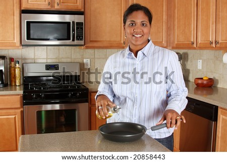Woman cooking in the kitchen of her home