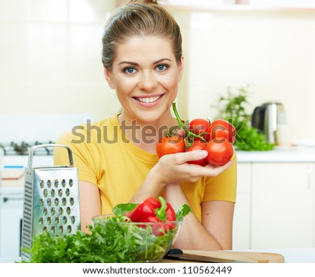 woman cooking vegetables green  salad in the kitchen - stock photo