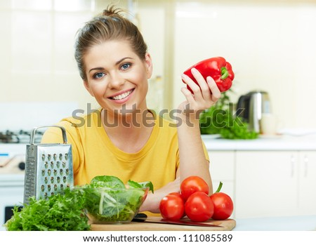 woman cooking vegetables in the kitchen - stock photo