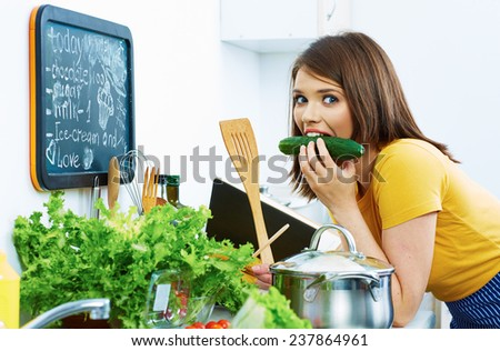 Woman cooking with fun. Kitchen. - stock photo