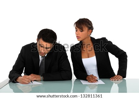 Woman copying on her workmate - stock photo