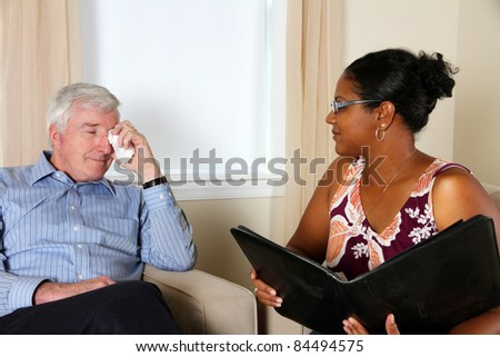 Woman Counseling a Man in Her Office - stock photo