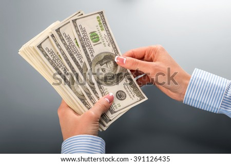 Woman counting bunch of dollars. Female hands counting dollars. Let's start counting. I wonder if they lied. - stock photo