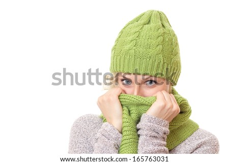 Woman covered her mouth and nose or face with scarf. Close up girl wearing winter clothes, isolated on white - stock photo
