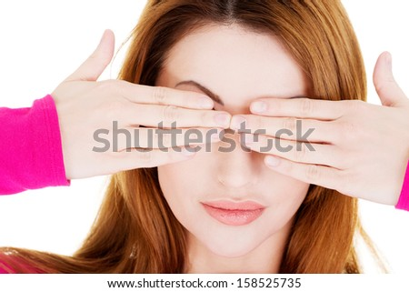 Woman covering eyes with her hands over white background  - stock photo