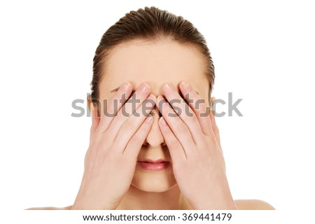 Woman covering her eyes. - stock photo