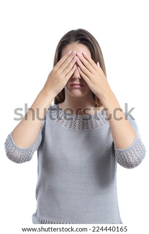 Woman covering her eyes with hands isolated on a white background - stock photo