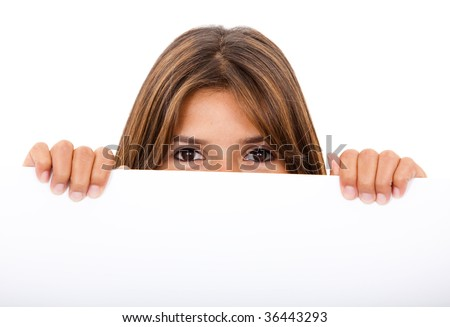 Woman covering her face with a banner isolated
