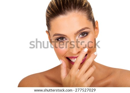 woman covering her mouth and laughing isolated on white background - stock photo