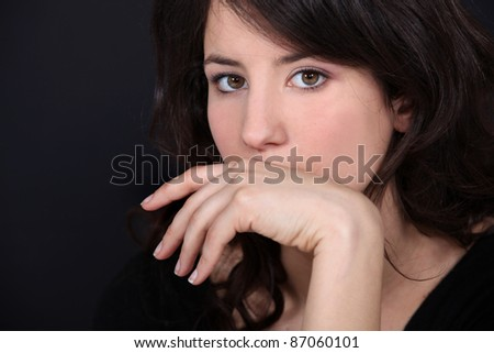 Woman covering her mouth with her hand