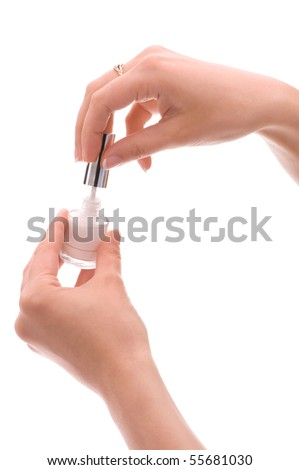 Woman covering her nails with nail polish