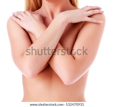 Woman covers her breasts with hands, isolated on white background