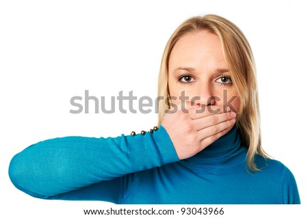 Woman covers her mouth with hand: Freedom of speech concept - stock photo