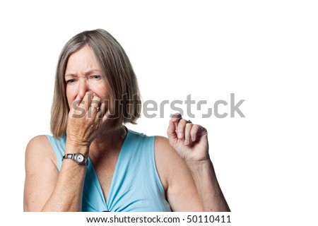 Woman covers her nose due to a bad smell - stock photo