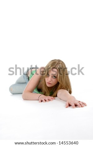 woman crawling on floor toward camera in sexy pose - stock photo