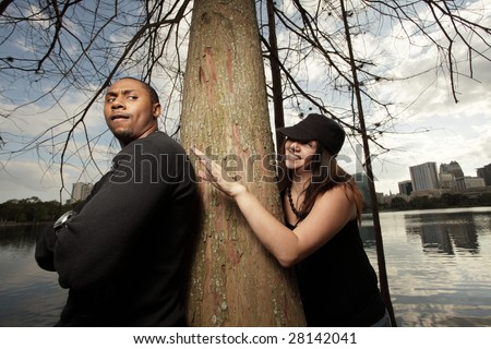 Woman creeping up on the man - stock photo