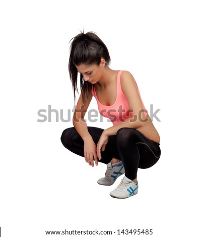 Woman crouching in their training isolated on white background