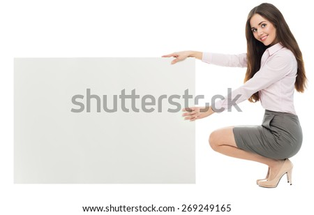 Woman crouching with blank sign - stock photo