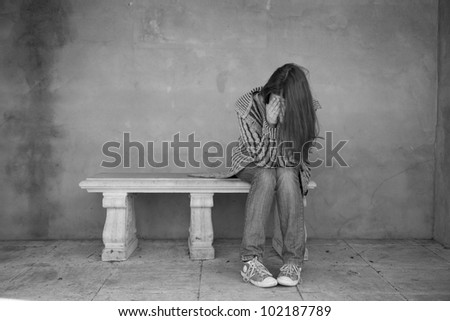 Woman crying on the bench - stock photo