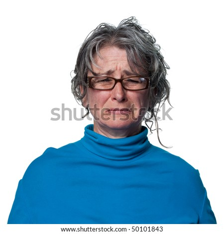 Woman crying tears, visibly upset and sad - stock photo