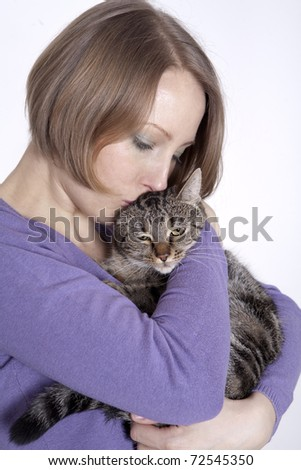 Woman cuddling her cute little young kitten isolated on white background - stock photo