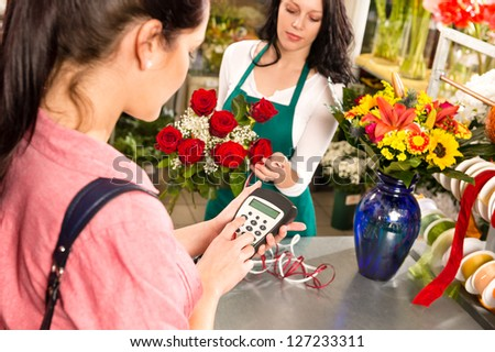 Woman customer paying flowers shop credit card florist roses - stock photo