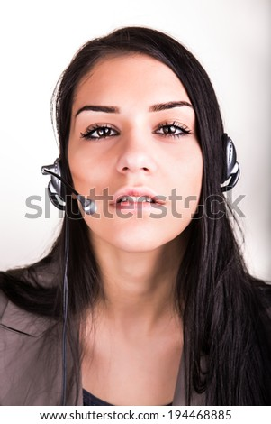Woman customer service worker, call center female operator with phone headset - stock photo