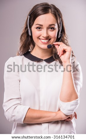 Woman customer service worker, call center smiling operator with phone headset. - stock photo
