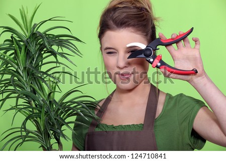 woman cutting a plant - stock photo