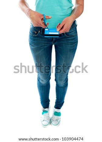 Woman cutting credit card with scissors. Cropped image