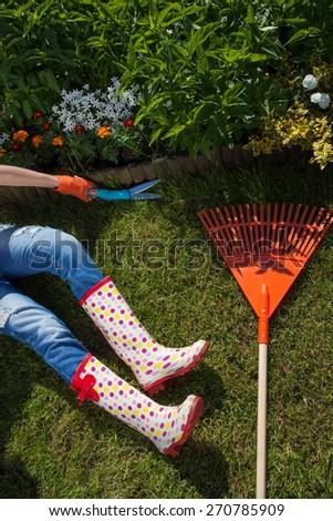 Woman cutting grass, gardening concept - stock photo