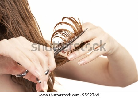 woman cutting her hair - stock photo