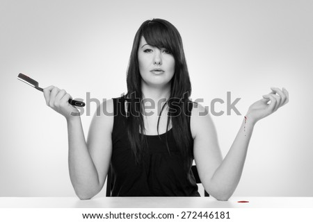 Woman cutting her wrist wit a cut throat razor - stock photo