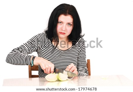 woman cutting onion in the Kitchen - stock photo
